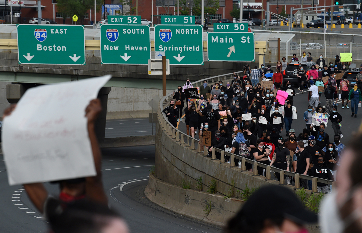 Hartford, CT - 6/1/20 - Protesters take over Route I-84 Monday evening demanding action against police violence against people of color. Photo by Brad Horrigan   bhorrigan@courant.com