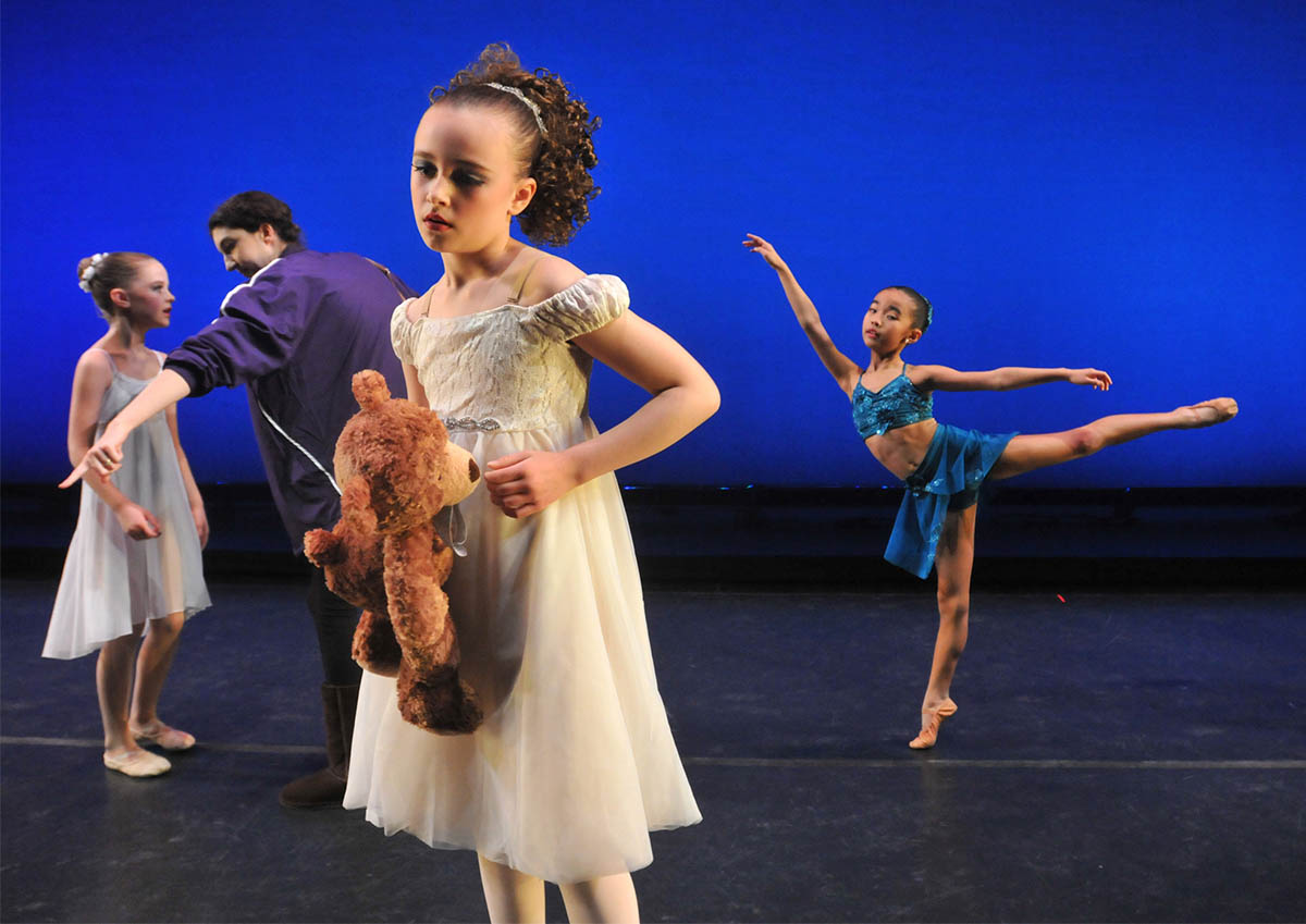West Hartford - 03/22/13 - Abigail Gorrell, center, 9, of the Academy of Russian Ballet in Manassas, VA, thinks through her performance during open stage Friday at the University of Hartford's Millard Auditorium.  Gorrell's contemporary ballet entry in the Youth America Grand Prix, was called {quote}Me and My Bear.{quote} BRAD HORRIGAN | bhorrigan@courant.com EDITOR'S NOTE: 'Open stage' is the warm up on the stage (behind the curtain) before the competition.