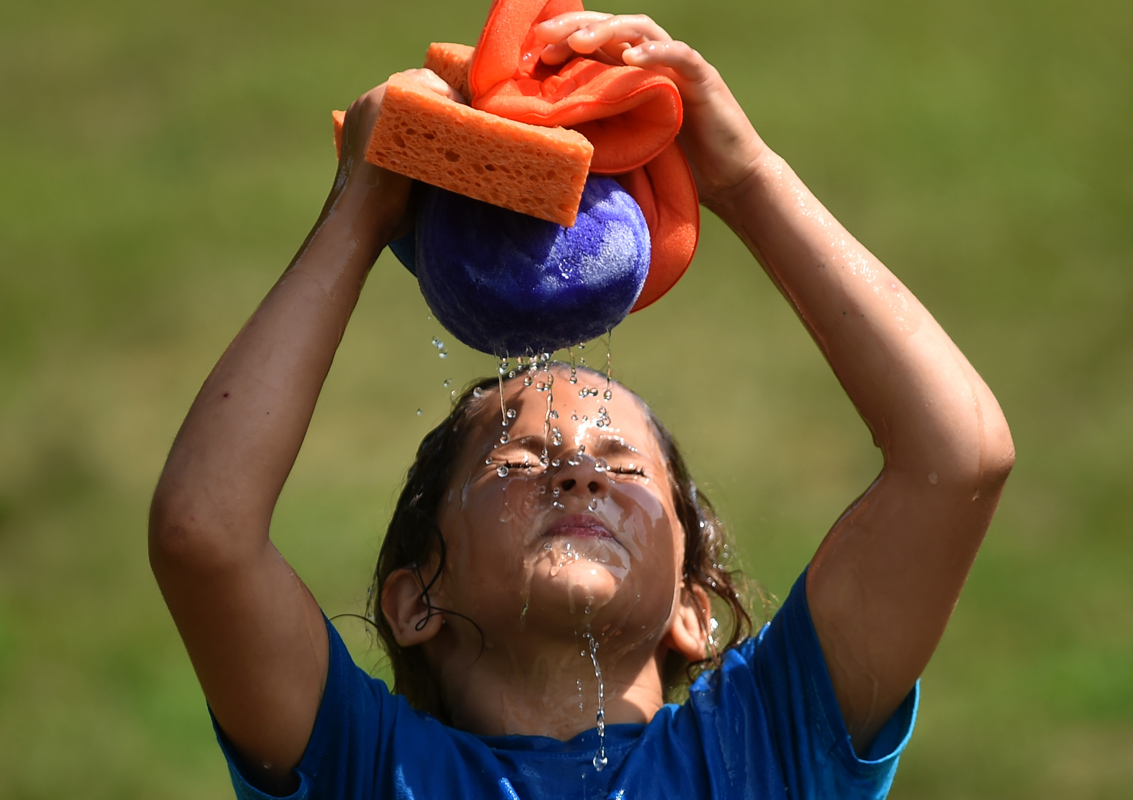 Second grader Leah Costa cools down in the {quote}wet seat{quote} during Fun Day at Brooklyn Elementary School.