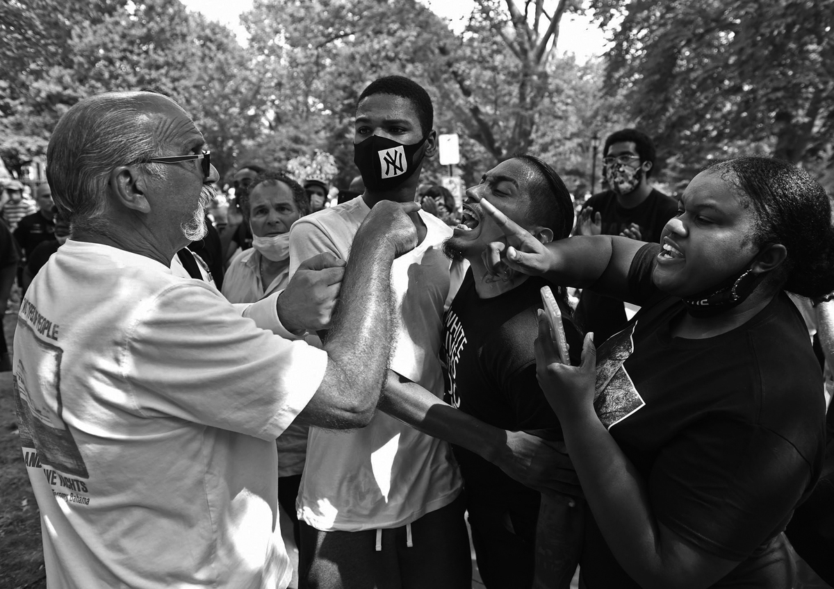 A confrontation about a Christopher Columbus statue erupts on New Haven's Wooster Square.