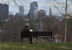 Mariann Yarborough reads a book at Sunrise Overlook in Elizabeth Park during the COVID-19 pandemic.