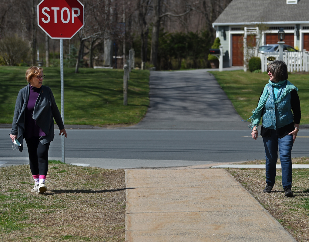 Longtime friends Meri Miselis, left, and Cindy Lincoln walk in Glastonbury. The two have been walking together on and off for over 30 years but now keep their distance duging the pandemic.