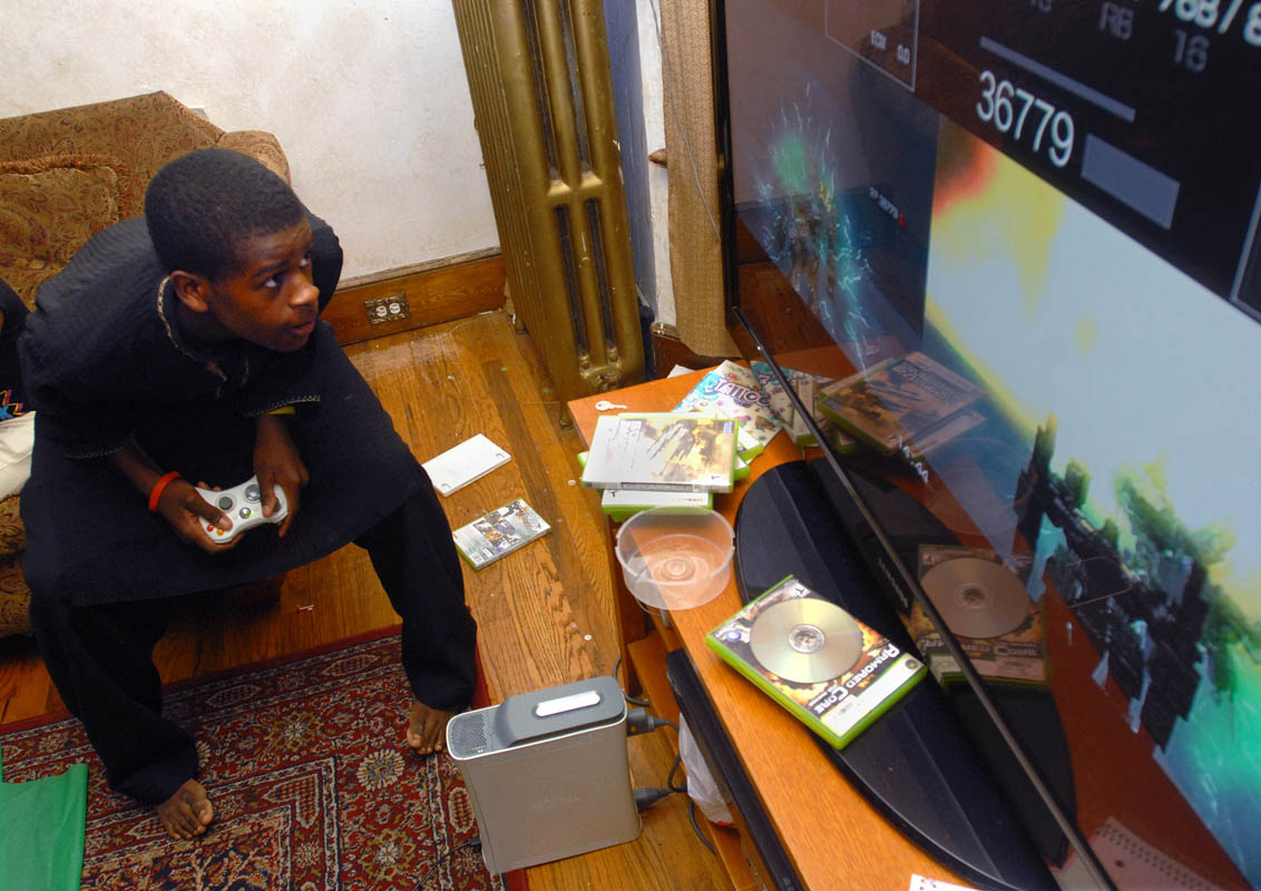 Ismail Abdussabur plays his xbox360 at his New Haven home.