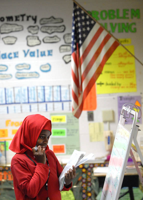 Salwa Abdussabur concentrates on a math problem during class at Vincent E. Mauro School.  After 7 years of homeschooling, she attended 5th grade in public school.