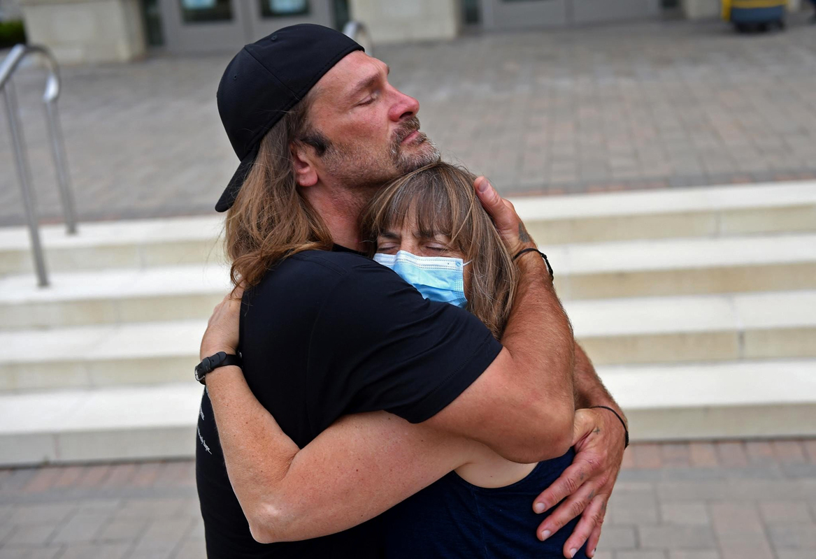 Shawn Henning, left, hugs Lori Freedman, a social worker at Centurion, on the steps of Connecticut Superior Court in Torrington Friday morning. After serving over 30 years in prison, charges against Henning, which included murder, were dismissed at the hearing.