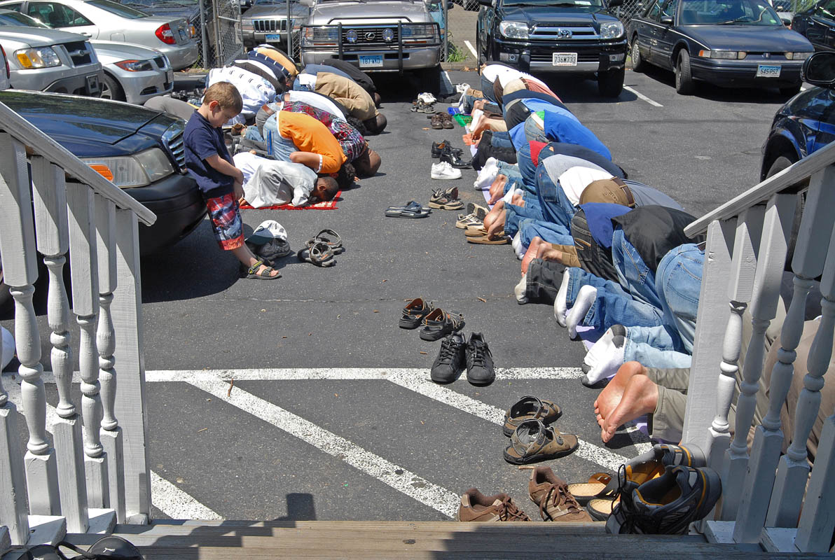 Heavy Jummah turnout, the Friday midday prayer, forced some to pray in the New Haven Islamic Center's parking lot.
