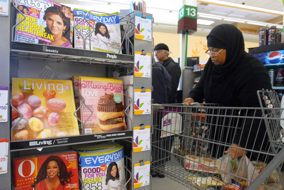 Khaliah Abdussabur picks up a few groceries early one Saturday morning.