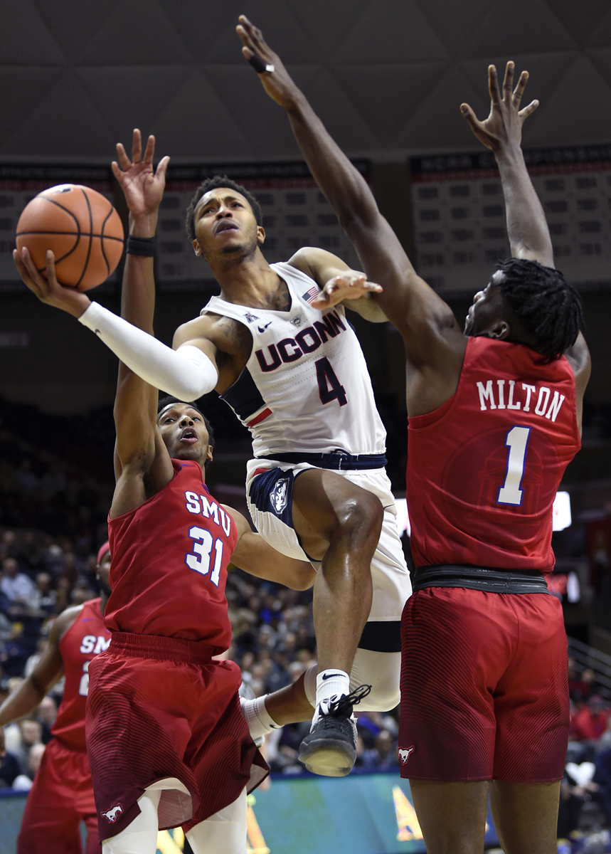 Storrs, CT - 1/25/18 - Connecticut Huskies guard Jalen Adams (4) floats to the basket between Southern Methodist Mustangs guards Jimmy Whitt (31) and Shake Milton (1) at Gampel Pavilion Thursday night. UConn won the game 63-52. Photo by BRAD HORRIGAN |bradhorrigan@courant.com