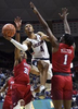 Storrs, CT - 1/25/18 - Connecticut Huskies guard Jalen Adams (4) floats to the basket between Southern Methodist Mustangs guards Jimmy Whitt (31) and Shake Milton (1) at Gampel Pavilion Thursday night. UConn won the game 63-52. Photo by BRAD HORRIGAN  bradhorrigan@courant.com