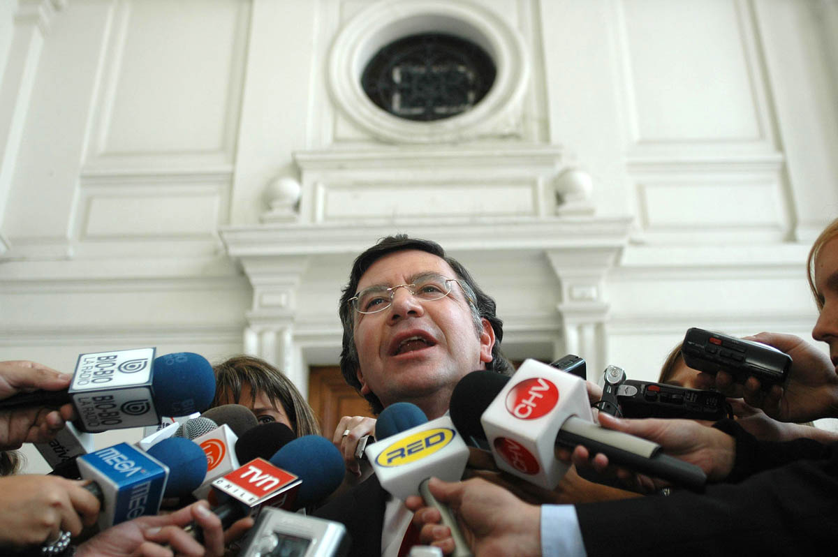 Joaquín Lavín speaks to the press during his campaign for the presidency.  He ran with the backing of the Independent Democratic Union partywhich has conservative holdovers from  the days of Pinochet.  Lavín has also praised Pinochet's economic policies in his writings.
