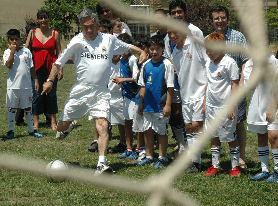 National Renewal party presidential candidate Sebastian Piñera lines up a penalty kick at Real Madrid Football School on the outskirts of Santiago on Christmas day 2005.  He lost his presidential bid in 2006, but was victorious in 2010 and now serves as president.