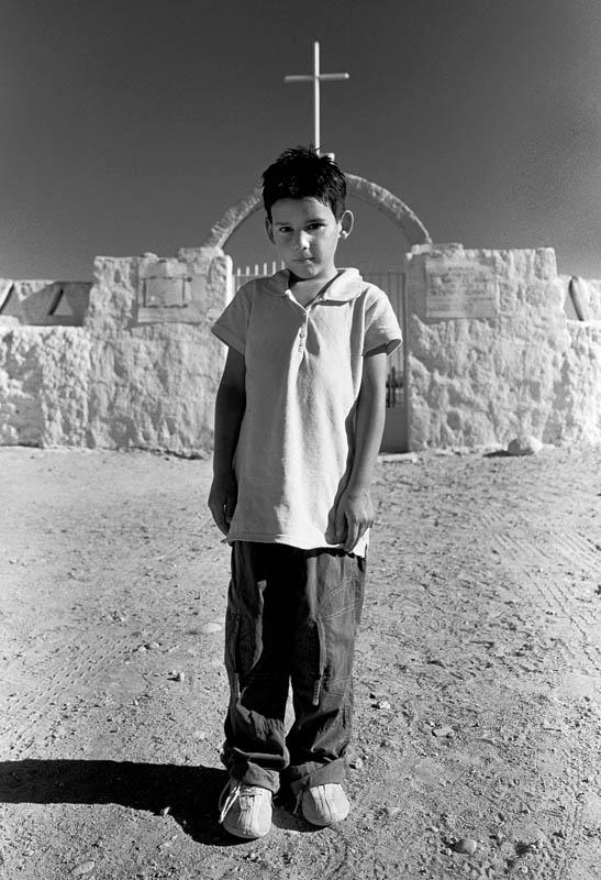 Boy outside a cemetery in San Pedro de Atacama.