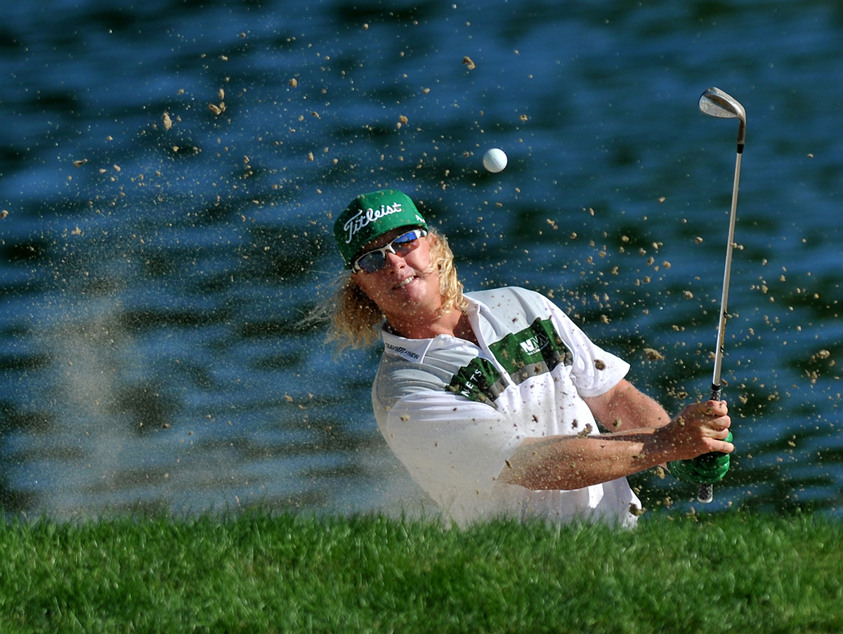 Charley Hoffman hits out of the bunker on the 17th hole on the final round at the Travelers Championship at TPC River Highlands.