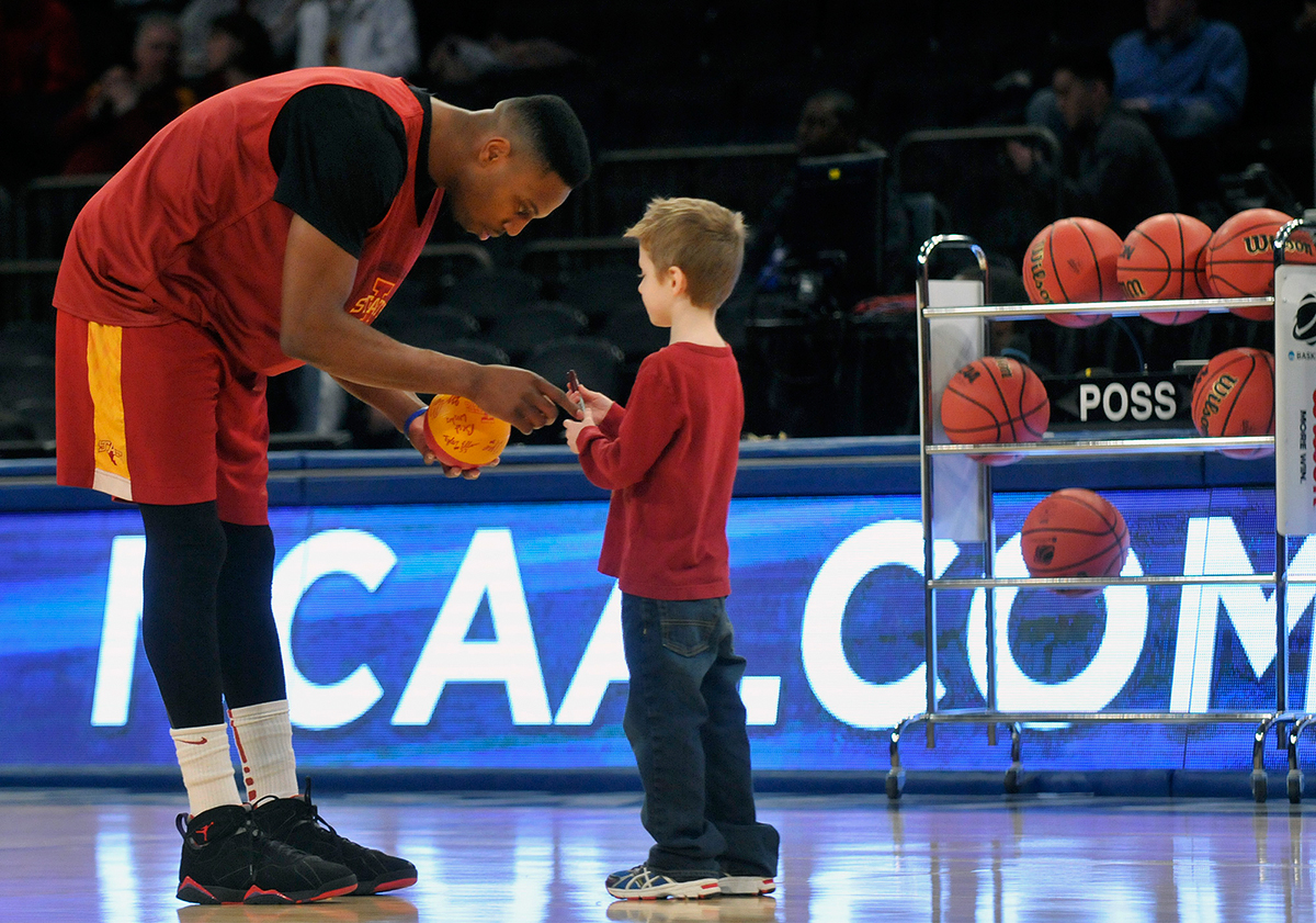 New York, NY -  03/27/14 - Iowa State's Melvin Ejim, signs an autograph for Noah Miller, 7, of Mt. Kisco, NY, during Thursday's practice at Madison Square Garden ahead of Friday night's NCAA east regional semifinal game against UConn.  Miller's parents are both from Iowa. Photo by BRAD HORRIGAN | bhorrigan@courant.com
