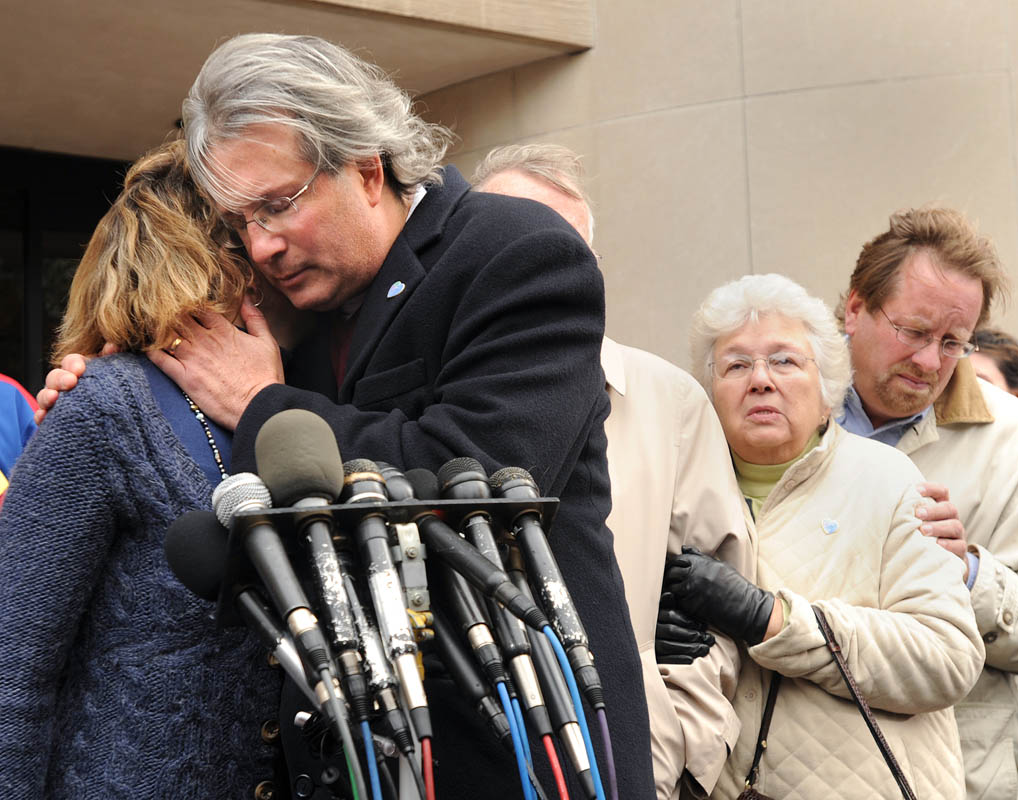 Dr. William Petit, second from left, hugs sister Johanna Chapman outside Superior Court in New Haven after Steven Hayes (not pictured) was sentenced to death.  Hayes was convicted on 16 of 17 counts, among them physical assualt, rape, arson and murder.