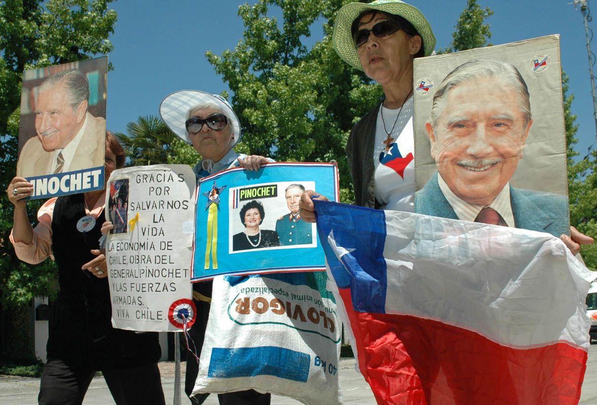 Supporters of former-dictator Augusto Pinochet supporter outside his home on his 90th birthday.