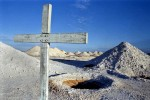 A cross stands in memorial to a fallen opal miner in Coober Pedy, Australia.