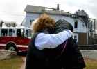 Joyce Perillo, right, gets a hug from her aunt Gerri Tuck, left, at the scene of the blaze at Perillo's Wallingford, CT home.