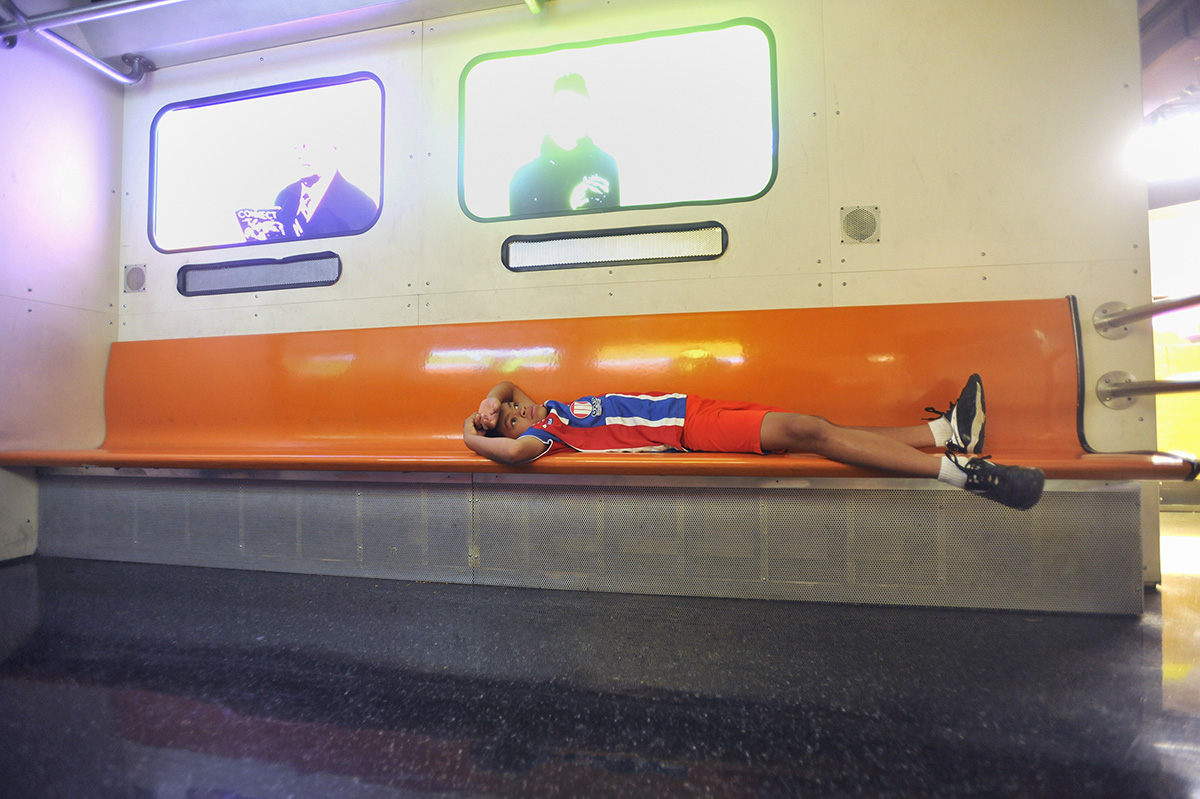 Allen lays down and takes in a subway exhibit at the Liberty Science Center in Jersey City.