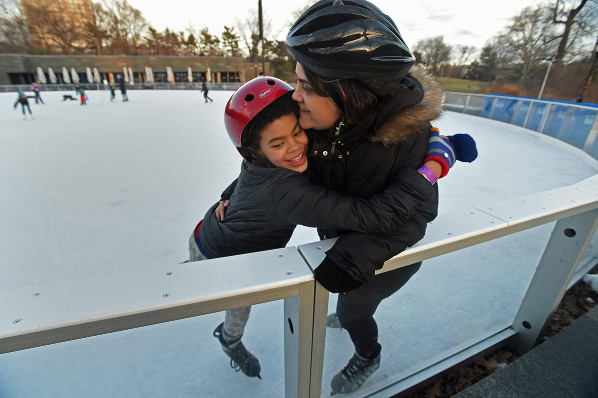 Allen hugs his mother while ice skating at Prospect Park for his 10th birthday party.