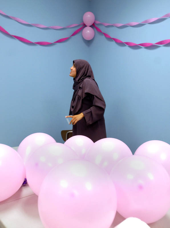 Head administrative assistant Jasmine Qureshi decorates a classroom for a surprise party in honor of Madiha Boulaksout's maternity leave.  Boulaksout, not pictured, is a secretary at Salma K. Farid Academy.