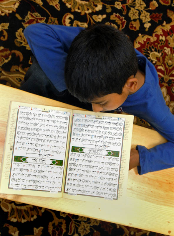 Khizr Zaheer, a third grader at Salma K. Farid Academy during its first school year, reads a Qur'an during Islamic Studies class.