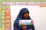 First grade teacher Matiniah Yahya helps introduce her students to one another on the first day of class.