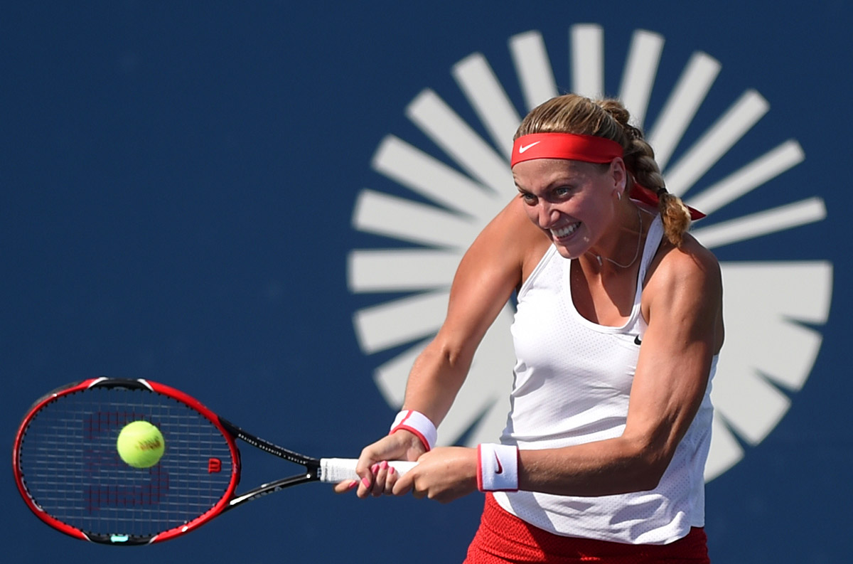 New Haven, CT - 08/29/15 - Petra Kvitova hits a backhand against  Lucie Safarova Saturday in the singles final at the Connecticut Open. Kvitova won the match an her third championship in New Haven. Photo by BRAD HORRIGAN | bhorrigan@courant.com