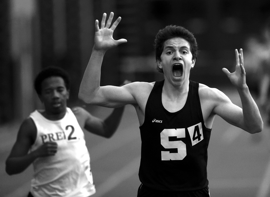 Staples runner Morgan Fierro, right, is overcome with emotion after beating Fairfield Prep's Azaan Dawson to the finish line in the boys' 1600 meter run at the CIAC Class LL indoor track and field championships at the Floyd Little Center in New Haven Thursday.