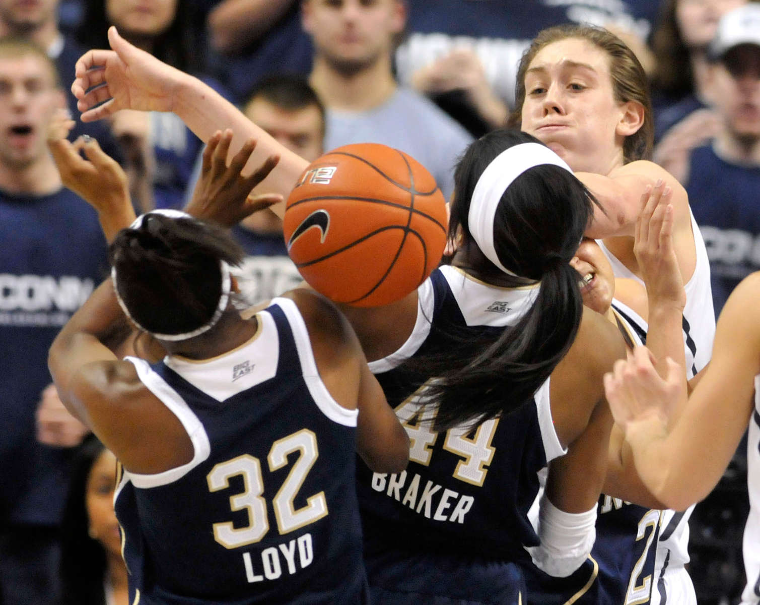 Notre Dame players Jewell Loyd and Ariel Braker battle UConn's Breanna Stewart for a loose ball at Gampel Pavilion.