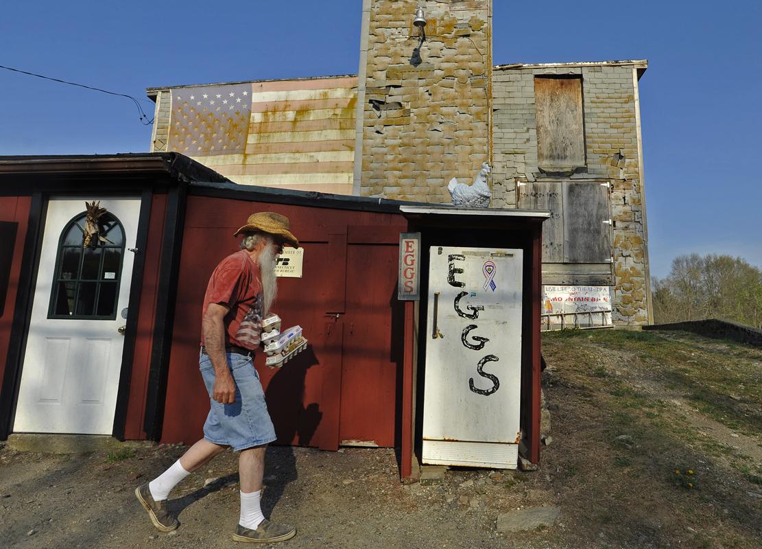 Poultry farmer Wayne Sweet drops eggs of in his sales fridge in Brooklyn.