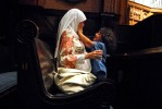 Marwa El-Sayed and her son Adam Masoud, 4, enjoy a private moment during a {quote}community iftar{quote} at Battell Chapel.  An iftar is when Muslims break their daily fast after dusk during the month of Ramadan.  For this particular iftar, Yale Muslims were encouraged to invite friends regardless of the religious denomination.  El-Sayed and her son live in Cairo, Egypt, but are visiting a friend who is a professor at Yale.