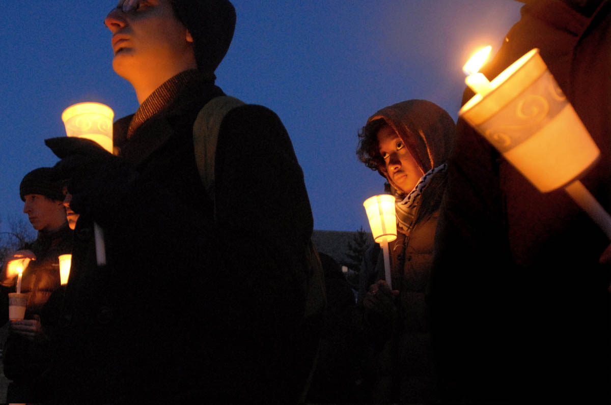 Nisreen Hasib takes part in a candlelight vigil on Yale's Cross Campus in early 2009.  The vigil was an opportunity to reflect on the civilians who had died in the conflict in Gaza.  The event was co-sponsored by the Yale University Chaplain's Office, the Muslim Students Association, the Joseph Slifka Center for Jewish Life and the Multi-Faith Council.