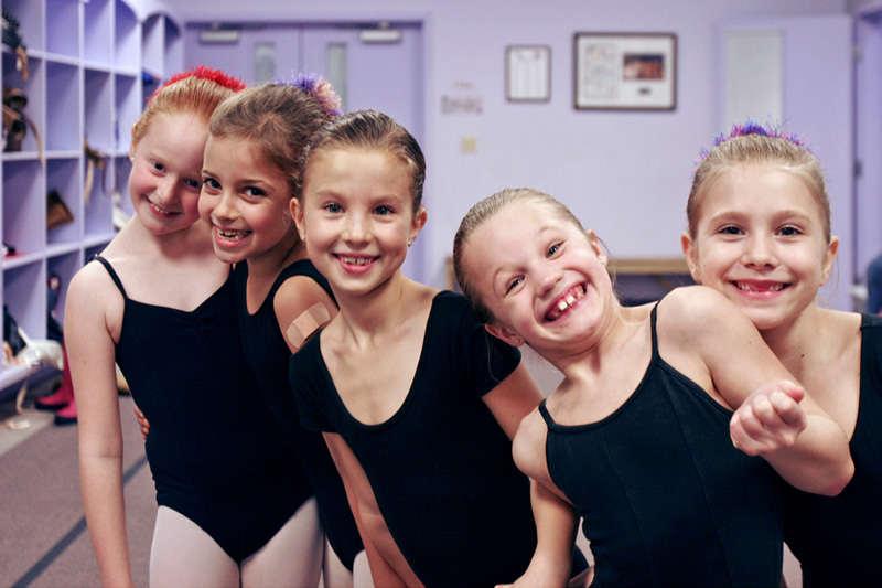 Young ballet students enjoy posing for the camera  in the lobby of Marcia Weary's Central Pennsylvania Youth Ballet.