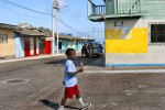A young boy in Puerto Baquerizo Moreno on San Cristobal Island is perfectly satisfied with his purchase.