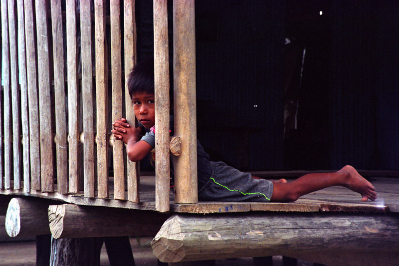A young man at home in his village along the Ucayali River in Peru.