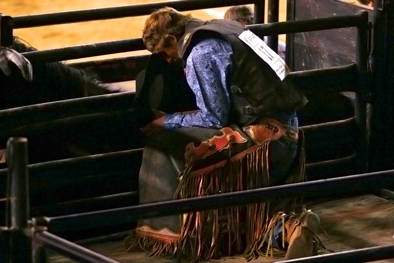 A moment of prayer before competing in the bullriding event.