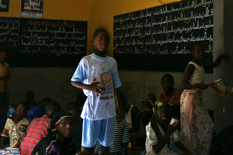 Boys and girls study reading, writing and math in traditional Qur'anic schools in Senegal. Generally, parents want their children to attend for at least three years to learn moral values taught in the Qur'an. Students who stay longer often become mentors for the younger children. When a student has surpassed the capacity of his or her marabout, he or she may move in order to live with another more knowledgeable teacher. Some criticize these schools for keeping children from attending modern schools. Stronger criticisms have been leveled at inappropriate use of the children for begging and raising funds for their teacher. This Dickensian life of some children is embarrassing to many Muslims and recently the government has taken steps to prevent it.