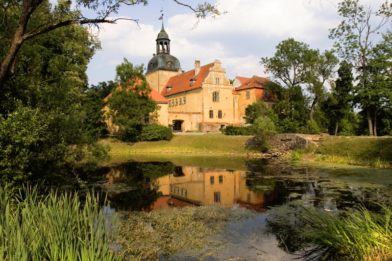 Straupe Castle, built in 1263, is located in Latvia's Gauja National Park. The castle complex includes Lielstraupe Church. Originally Romanesque in design, following a fire in 1905 the church tower was reconstructed in the Baroque style.