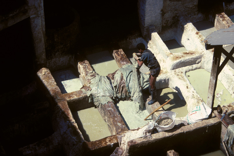 The oldest tannery in the world. Tanners in Fez, Morocco tolerate the same working conditions as those experienced by their 11th century predecessors.