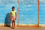A resident of Puerto Baquerizo Moreno, a young girl stands in the sun on San Cristobal Island.