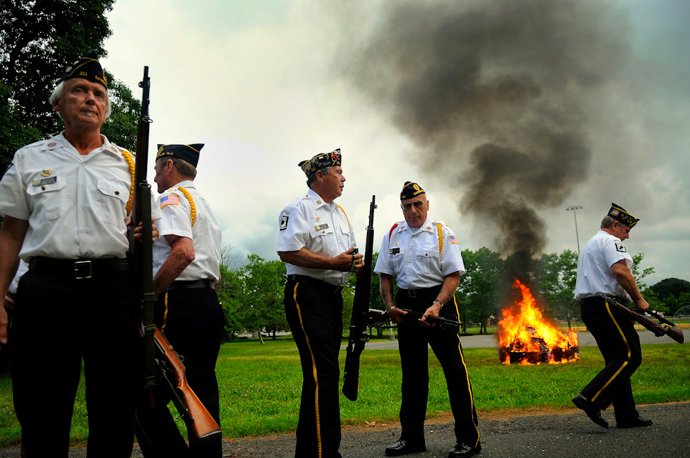 Members of the American Legion break out of formation during the flag retirement ceremony held at American Legion Post 211 in Sayreville, New Jersey on June 14, 2011.  American Legion Post 211 retired hundreds of flags during the ceremony.
