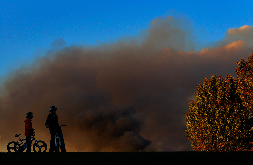 Smoke from the large brush fire fills the sky over River Road Park in Sayreville, New Jersey on November 3, 2010. The large fire burned down at least 100 acres along the Raritan River in Edison.