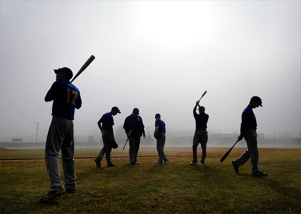 The Spotswood baseball squad waits patiently for the dense fog to dissipate prior to the scrimmage against Raritan held at Raritan High School in Hazlet, New Jersey on March 17, 2012.
