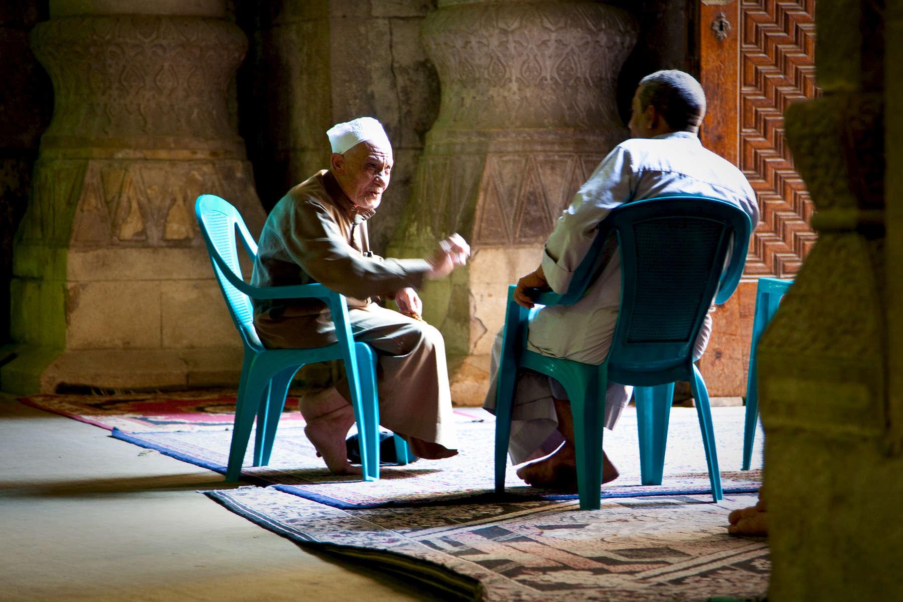 Caretakers chatting in the al-Rifa'i mosque. Cairo.