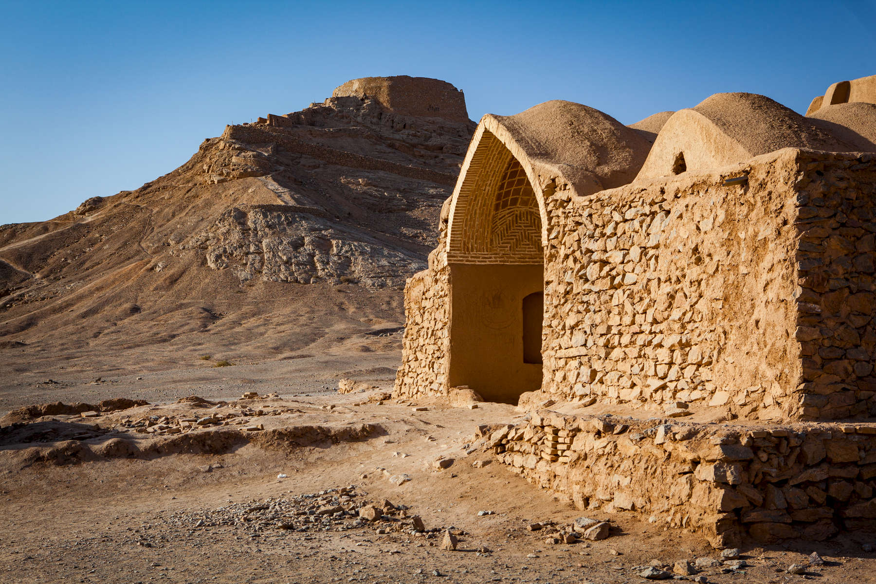 Zoroastrian Tower of Silence.The enclosure on the mountain top is one of many throghout Iran where followers of Zoroastrianism (the pre-Islamic religion of Persia) exposed their dead to the elements instead of burying them. They believed that burying the dead corrupted the earth.