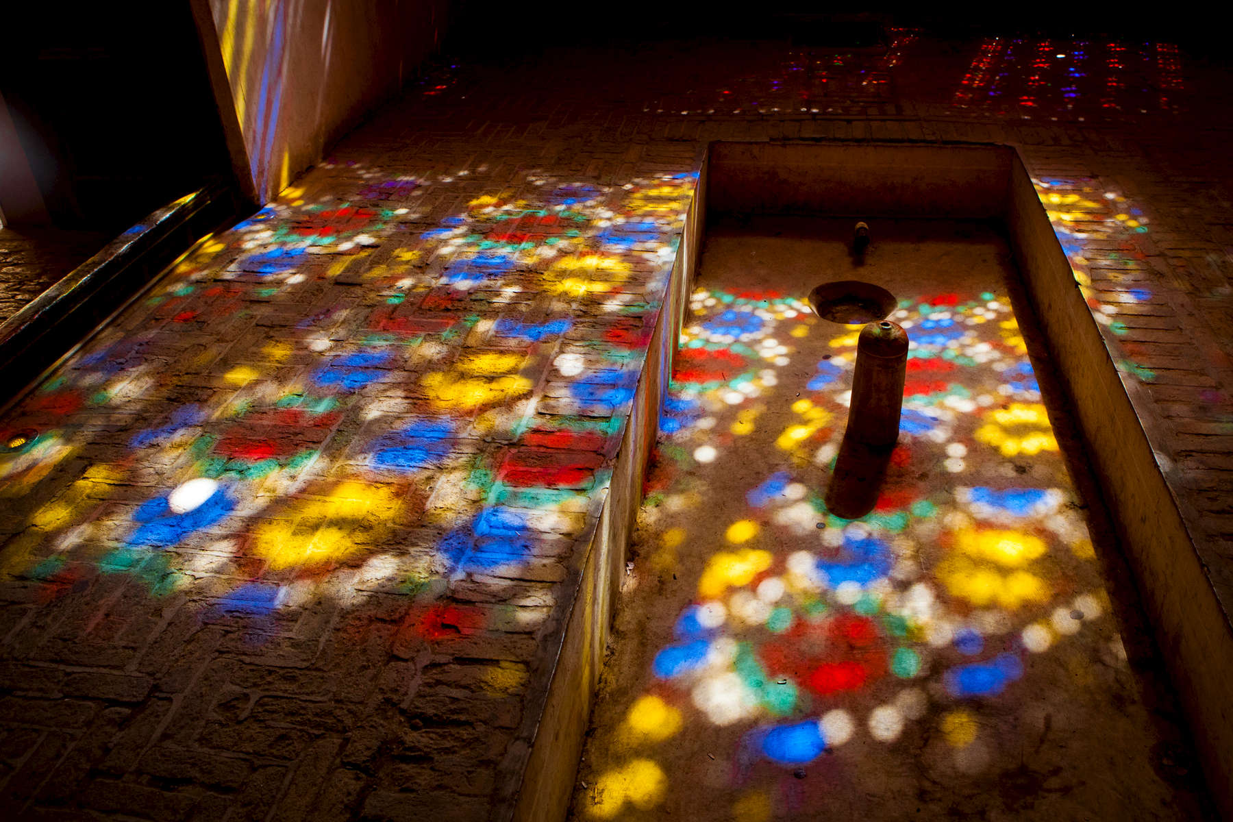 Stained glass light. Dowlatabad Garden. Yazd.