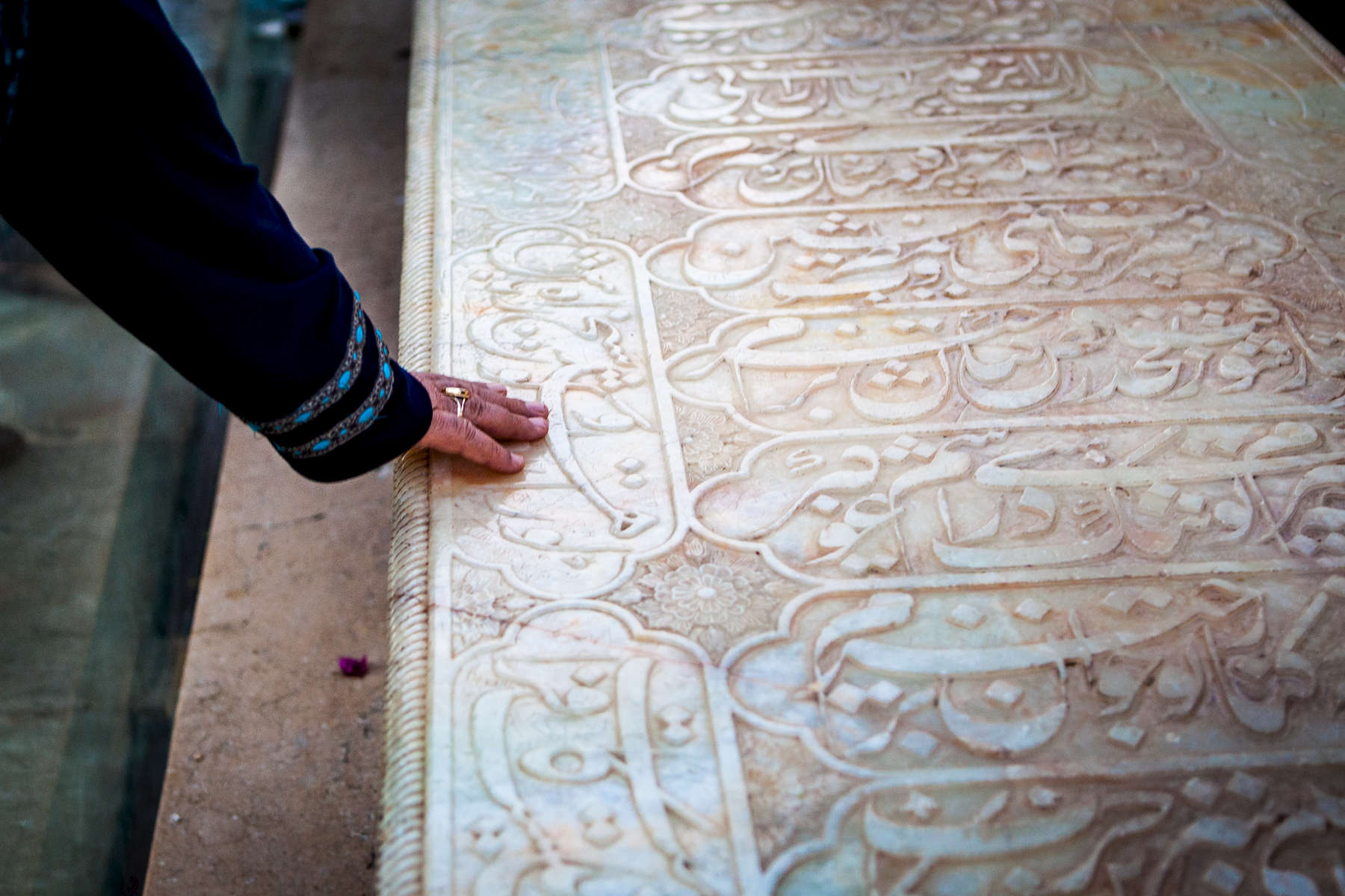 Seeking Blessings at Hafez's tomb (14th century). Shiraz.Persian poets are so venerated that Iranians visit their graves in the same way they make pilgrimages to the resting places of Sufi saints and other important religious figures.