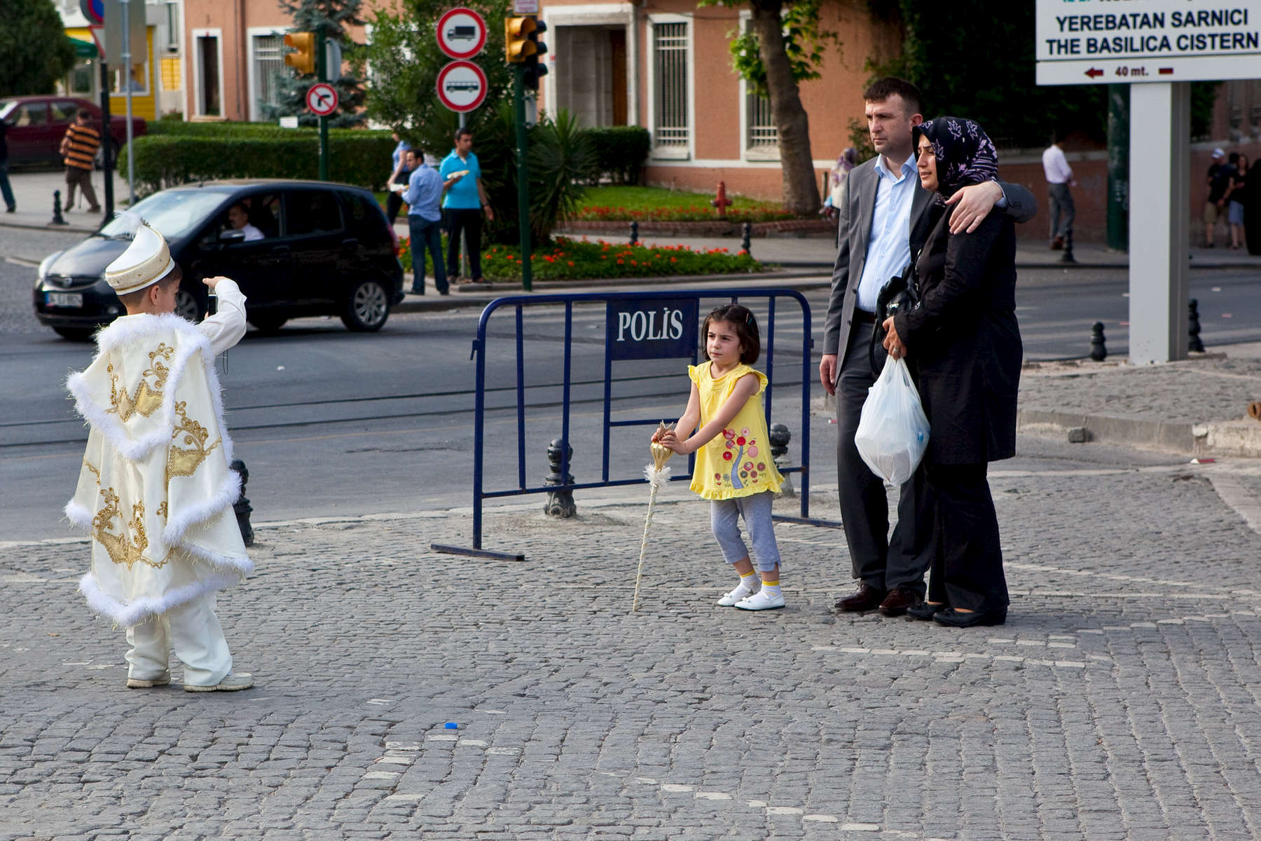 On the way to his sünnet (circumcision), a Turkish boy stops to photograph his family in the historic Sultanahmet district. Turkish boys are normally circumcised between childhood and adolescence, and the event is cause for great celebration as a ritual passage into manhood. Those circumcised are feted, feasted, and treated as {quote}Kings for a Day{quote}.