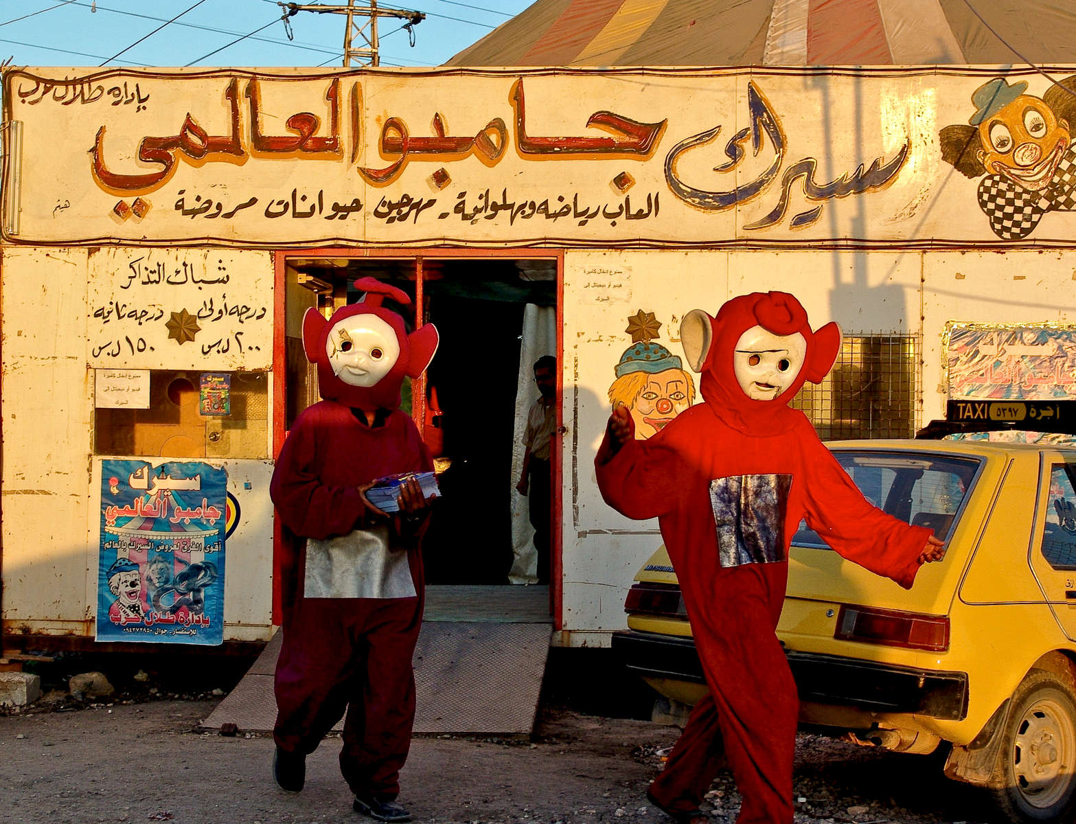 Circus promoters dressed as Teletubbies head out to distribute fliers.  Outskirts of Damascus.